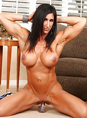 Elisa Ann is massive, ripped and so very sexy! She would love for you to worship her big hard muscles!