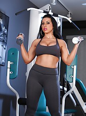 Brianna Jordan models her sweet body as she works out in the gym. She starts off by flexing her strong chest and biceps as she curls her weights.