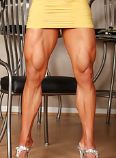 Angela Salvagno flexs her biceps, triceps, abs, quads and hamstrings before she starts to strip out of her dress.