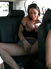 Nikki Jackson has a blast showing off her big boobs to Rachel Aziani in the car!