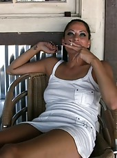 Cassidey sits outside smoking a cigarette while chatting and flashing her sweet pussy!