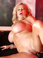 Rachel Aziani gets dolled up in a sexy corset and matching panties just to strip it off again.