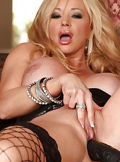 The sexy Rachel Aziani plays with a big black cock.