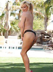 Blonde Rachel Aziani strips outside showing off her sexy tan lines.