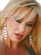 Blonde beauty Rachel Aziani performs a sexy outdoor striptease showing her big tits and clit.