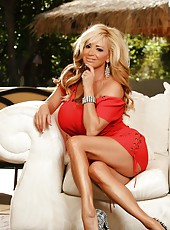 Gorgeous blonde, Rachel Aziani, lounges outside in her naughty red dress and zebra striped heels. She shows off her awesome big boobs and wet tight pussy to all.