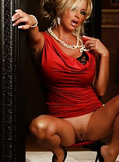 Hot busty babe, Rachel Aziani, looks amazing in her naughty red dress.  She puts on a sexy striptease revealing her big tits and tight little pussy.