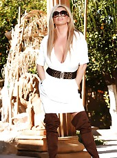 Beautiful busty blonde, Rachel Aziani, is so hot in her thigh-high boots and dress.  She puts on a very sexy outdoor striptease revealing her big boobs and amazing body!