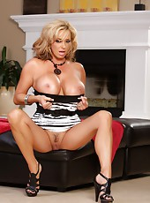 Beautiful busty blonde, Rachel Aziani, lifts her little dress and lets you see her pretty pink pussy.