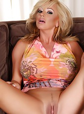Big breasted blonde bombshell Rachel Aziani takes off her psychedelic dress and shows off her big tits and smoking hot body!