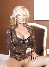 Las Vegas gets busty blonde, Rachel Aziani, so horny! Watch as she strips out of her sexy dress to reveal her big boobs and proceeds to finger her shaved pussy!
