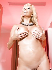 Sexy blonde babe, Rachel Aziani, gets so turned on stripping out of her naughty black dress that she just has to break out her toy and play with her tight shaved pussy!