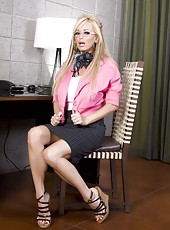 Blonde bombshell, Rachel Aziani, makes for one naughty secretary showing off her beautiful big boobs and playing with her big dildo!