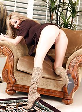 Gorgeous busty blonde, Rachel Aziani, shows off her wild side in her leopard print boots!