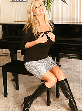 Rachel drops her skirt, leather boots, reveals her big natural breasts and shaved pussy