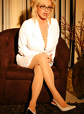 Rachel Aziani in white secretary outfit, glasses and stockings;