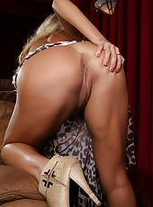 Mary Carey strips and models her sexy curves totally nude.