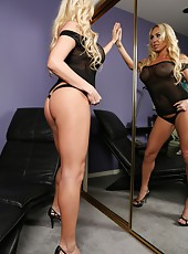 Blonde beauty Mary Carey strips then fingers her tight little pussy, getting it ready for her big black cock toy.