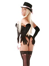 Beautiful busty blonde, Mary Carey, poses wearing her cool hat, sexy corset and booty shorts, gloves, heels and thigh highs.  Mary is smoking hot!