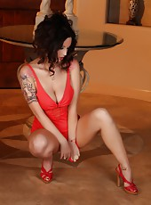 Nikki Nova strips off her red retro sexy dress in the foyer.