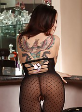 Nikki Nova poses in her black see through, crotchless, net, body stocking with little pink bows up the back. Her big tits and smoking hot body look phenomenal!