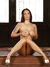 Hot sexy brunette, Nikki Nova, gives you a great look at her big boobs and perfect body as she gets naked.