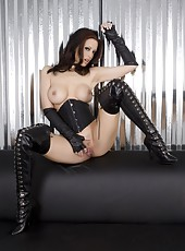 Brunette bombshell, Nikki Nova, gets naughty in her sexy thigh high boots and leather corset showing off her beautiful tits and sweet pussy!