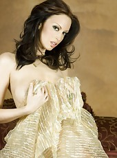 Hot busty brunette, Nikki Noval, looks like the perfect sensual present all wrapped up in her silk fabric with nothing on underneath!