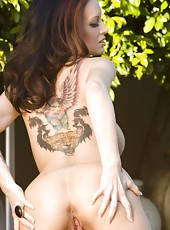 Brunette bombshell, Nikki Nova, gets naughty outdoors and strips off her sexy dress showing off her beautiful tits and sweet pussy!