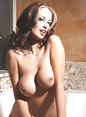 Busty brunette babe, Nikki Nova, loves taking a long soak in a bubble bath and showing off her incredible body to you!