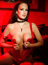 Nikki Nova is sultry and sex in her red bustier!