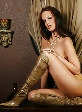 Nikki Nova looks amazing in her gold booty shorts and high boots!