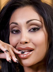 Sexy Indian Pornstar, Priya Anjali Rai, unleashes her inner wild woman and puts on a very hot striptease out of her naughty tiger-print dress showing off her big tits and pussy!