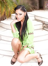 Gorgeous busty Indian Pornstar, Priya Anjali Rai, looks gorgeous posing outside in her green dress and stripping down to nothing!