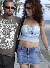 Check out this milf that gets banged while walking her dog at the beach