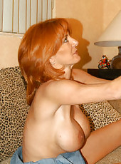 Redheaded babe with massive tits getting cum in the mouth