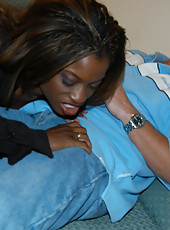 Ebony milf gets a load of cum shot all over her face