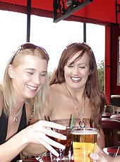 A sexy milf duo gets dowsed with cum and then swaps it in their mouths