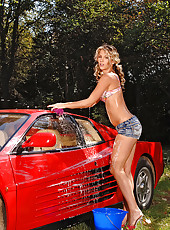 Stunning blonde washing a Ferrari