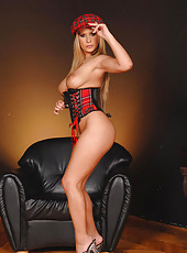 Busty babe wears sexy leather tube