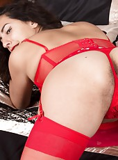 Liz is in her red polka-dot dress and red stockings and looks amazing. She reveals her beautiful hairy pits and hairy pussy and 3/4 of the way in, she spreads her legs. In between her hairy cunt looks nice.
