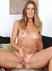 Blonde 50 year old LA Valkenberg spreading her pussy wide in here