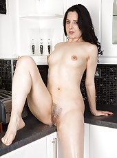 Brunette housewife Honesty gets herself all wet in the her kitchen
