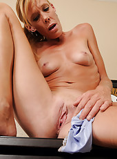 36 year old Stacey Y from AllOver30 stuffing her panties deep inside