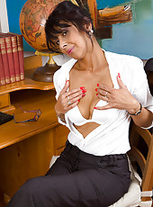 Horny old secretary Sophia Smith probing at her pussy with a pen