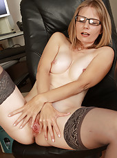 Horny blonde secretary Lexa Mayfair pulls open her box on the desk