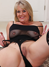 Naughty blonde 48 year old Sherri Donovan in fishnet lingerie posing