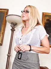 Busty blond Angela Attison fucks and sucks her coworkers cock in order to keep her job.