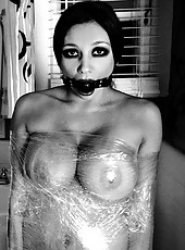 Audrey Bitoni wrapped in plastic