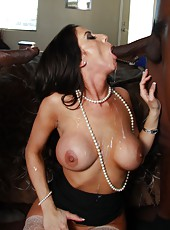 Hot brunette milf Gianna Foxxx service two big black cocks